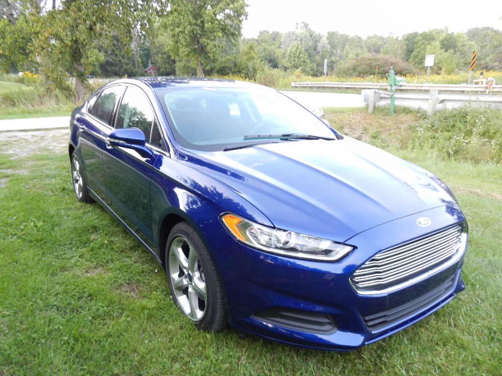 2013 ford fusion se 13900 buds auto used cars for sale in michigan buds auto used cars. Black Bedroom Furniture Sets. Home Design Ideas
